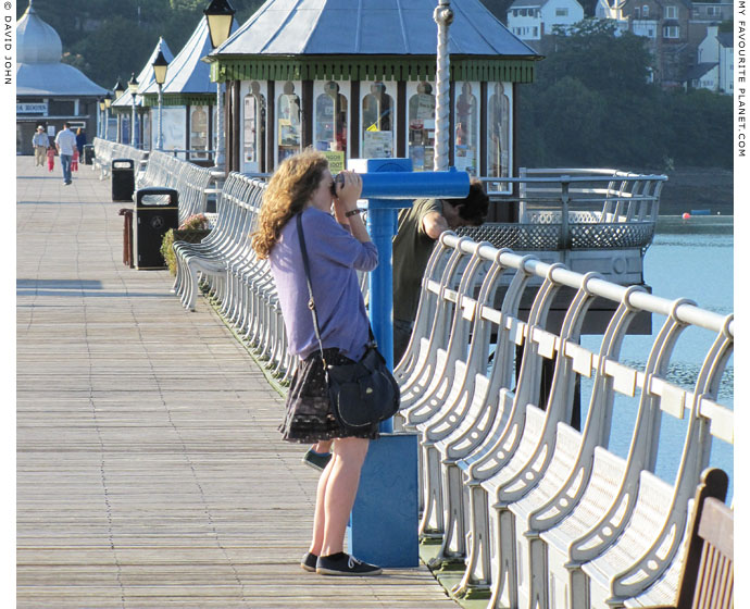 Owl Telescope user on Bangor Pier, North Wales at The Cheshire Cat Blog