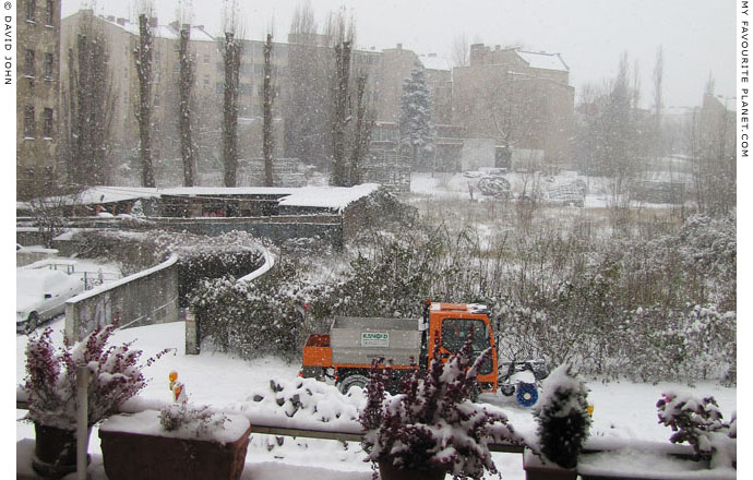 A snowplough in action on a Berlin street by David John at The Cheshire Cat Blog