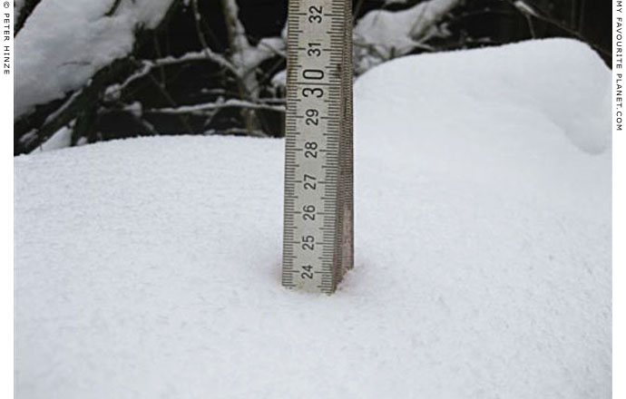 Measuring the depth of snow in Bernau by Peter Hinze at The Cheshire Cat Blog