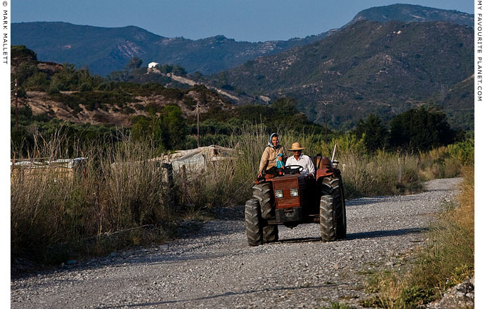 Farmers on a tractor in Rhodes, Greece by Mark Mallett at The Cheshire Cat Blog