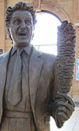 statue of comedian Ken Dodd, alias Professor Rufus Chuckabutty, by Tom Murphy, Lime Street Station, Liverpool at The Cheshire Cat Blog