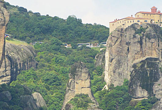 Tour bus convoy parked outside the monstery of Agios Stefanos, Meteora, Greece at The Cheshire Cat Blog