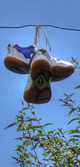 two old trainers hanging on the line at The Cheshire Cat Blog
