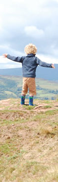Noah on top of Skirrid Fawr, South Wales at The Cheshire Cat Blog