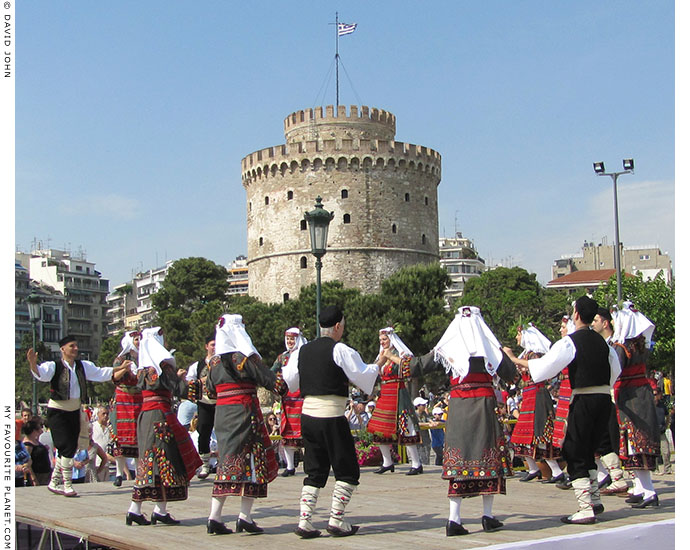 Macedonian dancers perform a traditional dance in front of Thessaloniki's White Tower, at The Cheshire Cat Blog
