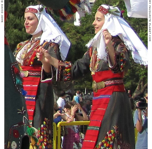 Young female Macedonian dancers performig a traditional Greek dance in Thessaloniki, Greece, at The Cheshire Cat Blog