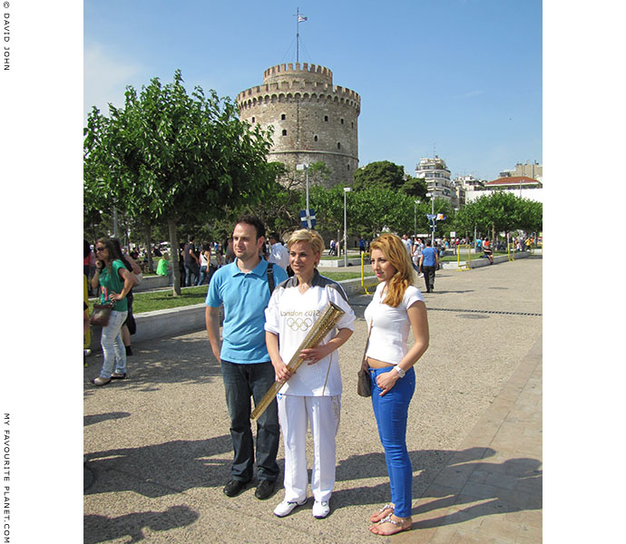 Greek Olympic torchbearer Giota Oikonomou and friends pose for fans at the end of the Olympic flame ceremony, Thessaloniki, Greece, at The Cheshire Cat Blog