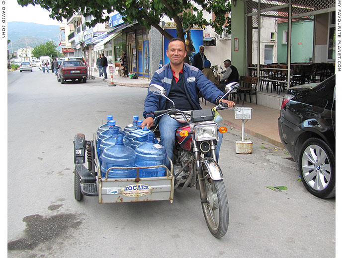 A water delivery man on a motorbike and sidecar in Söke, Turkey at The Cheshire Cat Blog