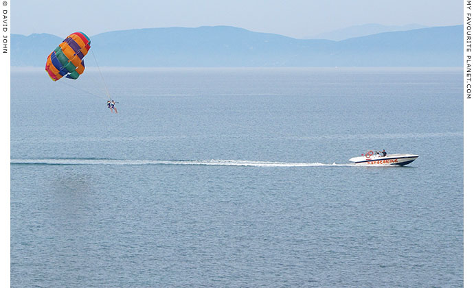 Couple parachute gliding off the coast of the Dilek Peninsula, Turkey at The Cheshire Cat Blog