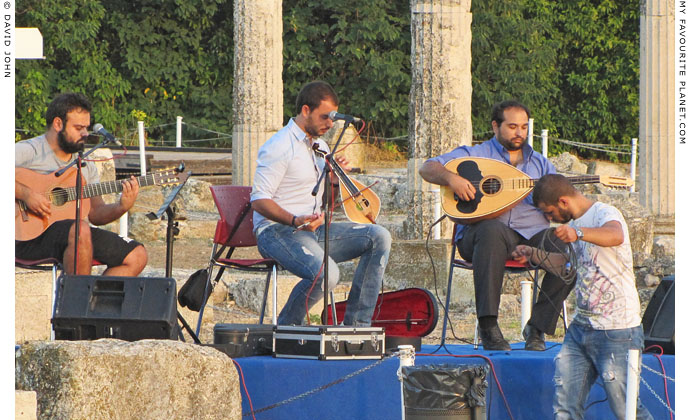 Cretan lyra player George Sfakianakis and his band at the archaeological site of Pella, Macedonia, Greece