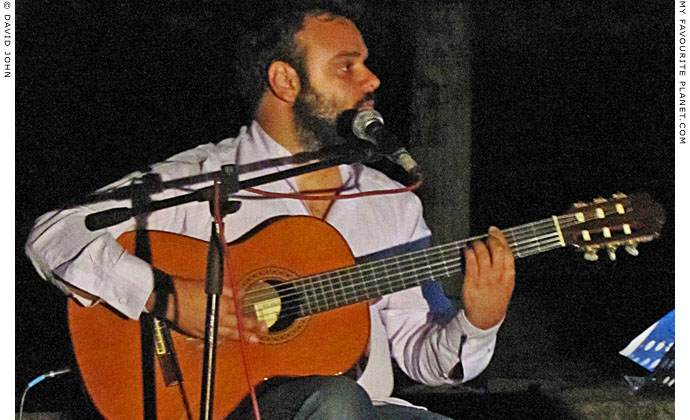 Guitarist playing traditional Cretan music in Pella, Greece at The Cheshire Cat Blog