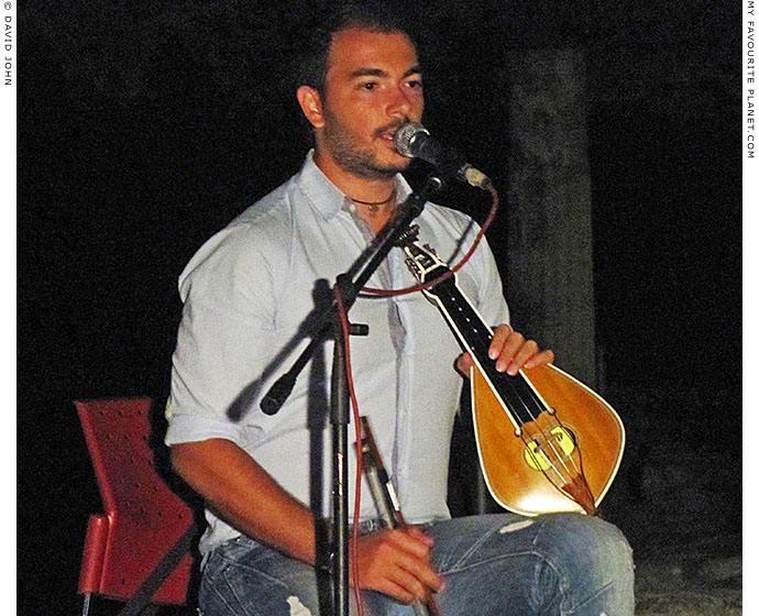George Sfakianakis plays lyra and sings traditional Cretan songs in Pella, Greece at The Cheshire Cat Blog