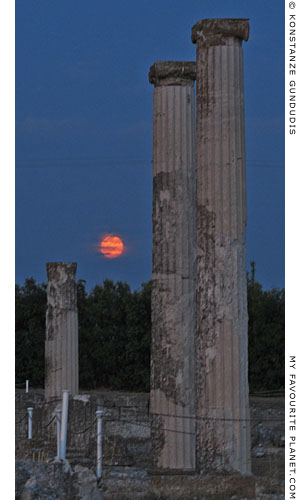 The moon rises behind the columns of the House of Dionysos, Pella, Macedonia, Greece at The Cheshire Cat Blog
