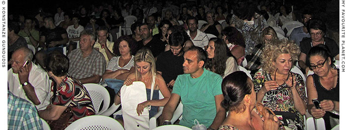 The audience at a concert of traditional Cretan music in Pella, Greece at The Cheshire Cat Blog