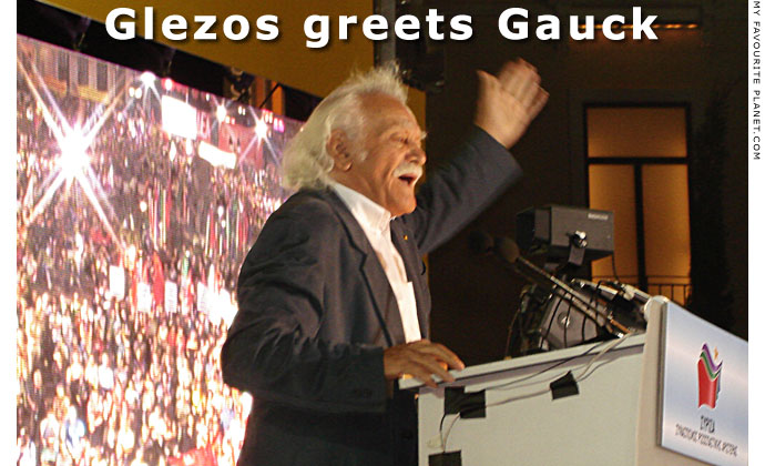 Glezos greets Gauck at The Cheshire Cat Blog