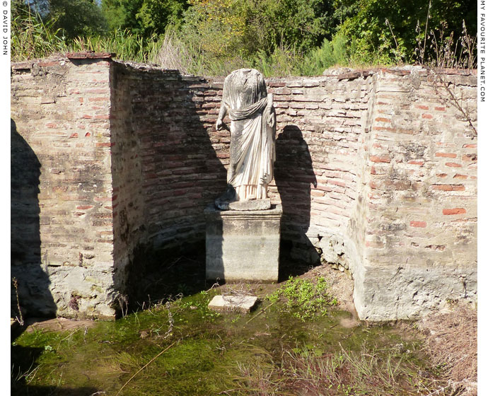 A statue of Isis-Tyche in the sanctuary of Isis, Dion Archaeological Park at The Cheshire Cat Blog