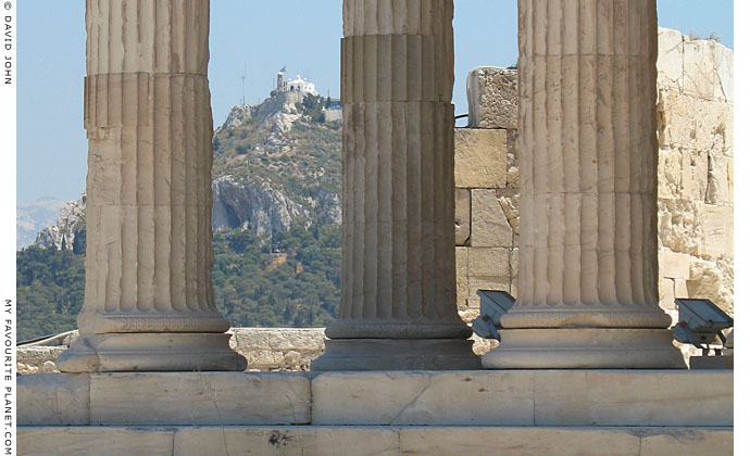 Ionic column bases of the Erechtheion, with Lykavittos Hill in the background at My Favourite Planet