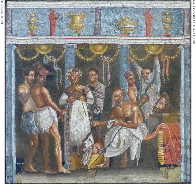 A choregos distributing masks to his to his actors on a mosaic from Pompeii at My Favourite Planet
