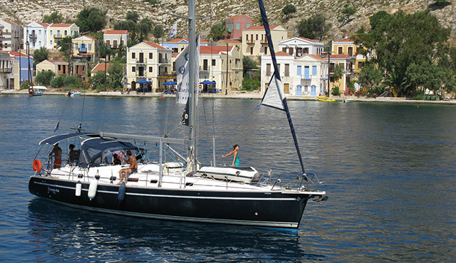 A private sailing boat leaving Kastellorizo harbour, Greece at My Favourite Planet