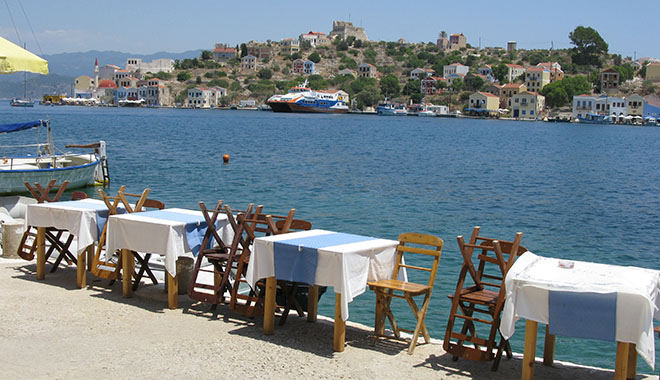 harbour-side restaurant tables during siesta time, Kastellorizo, Greece at My Favourite Planet