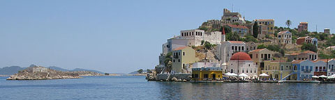 The Kavos headland and Psoradia from the west side of Kastellorizo harbour, Greece at My Favourite Planet