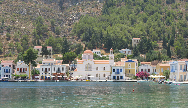 Harbour-side houses and Agios Giorgos Tou Pigadiou church in the centre of Kastellorizo, Greece at My Favourite Planet