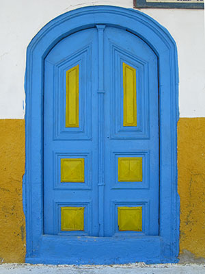 The blue and yellow door of Pantopoleion Potion drinks store, Kastellorizo, Greece at My Favourite Planet