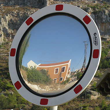 Convex traffic mirror on the way to the Knight's Castle, Kastellorizo, Greece at My Favourite Planet