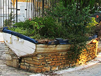 Old wooden boat outside the church of Saint George of the Fields, Horafia district, Kastellorizo, Greece at My Favourite Planet