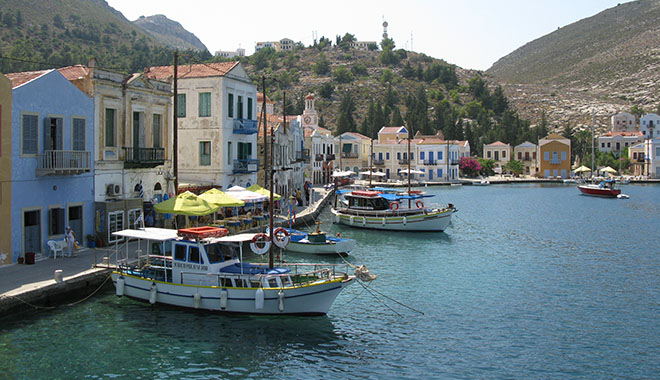 Cruise boats to the Blue Grotto and Ro island in Kastellorizo harbour, Greece at My Favourite Planet