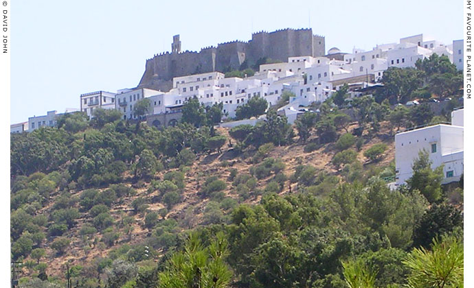 The whitewashed houses of Hora village clustered beneath the Monastery of Saint John, Patmos, Greece at My Favourite Planet