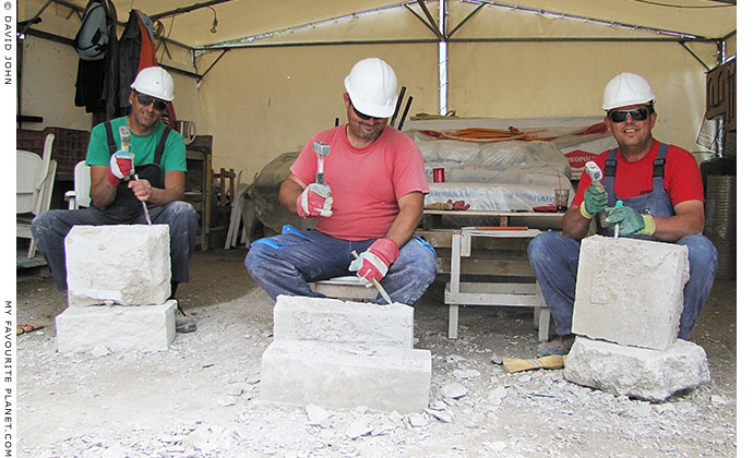 Stonemasons working during the restoration of the agora of Pella Archaeological Site, Macedonia, Greece at My Favourite Planet