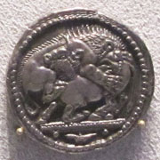 Silver tetradrachm of Akanthos, depicting a lion attacking a bull