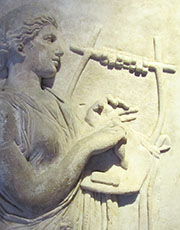A muse playing a cithara at My Favourite Planet