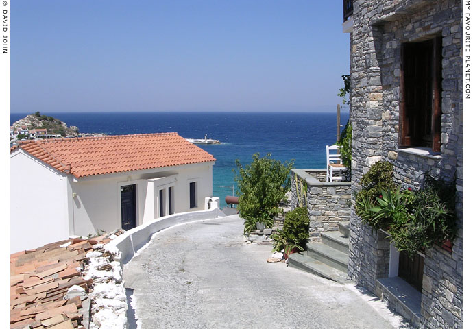 The street down from the main road to the east side of Kokkari harbour, Samos, Greece at My Favourite Planet