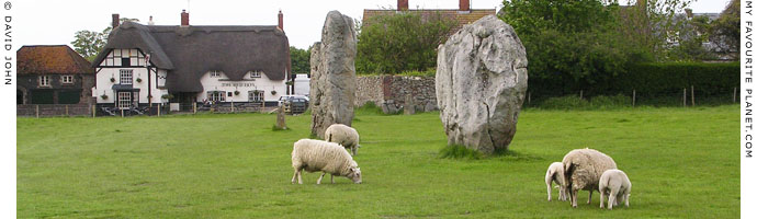 Megaliths of Avebury Henge, with The Red Lion pub in background