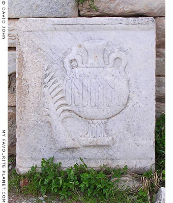 Marble relief of a palm branch and oil jar, Ephesus, Turkey at My Favourite Planet