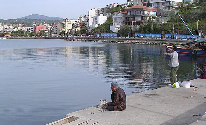 Local anglers on the causeway to Guvercin Ada (Pigeon Island), Kusadasi, Turkey at My Favourite Planet
