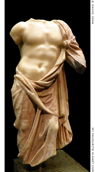 Fragment of a marble statuette of Asklepios with a red himation at My Favourite Planet
