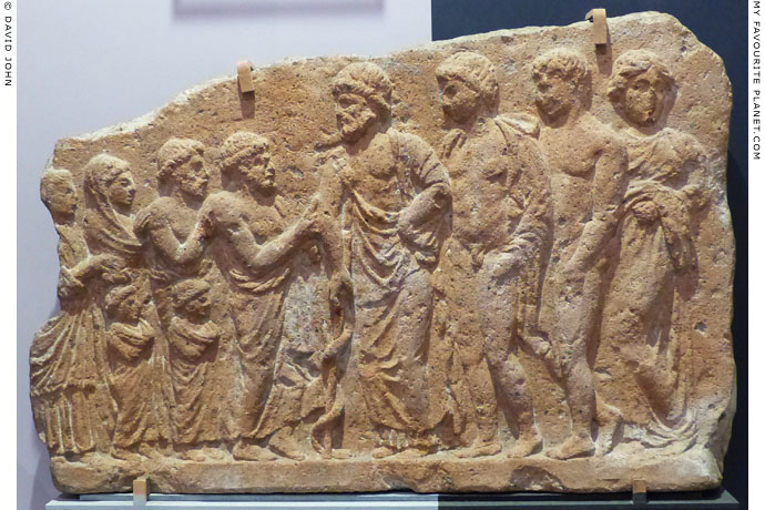 Terracotta votive relief of a family presenting offerings to Asklepios and his children at My Favourite Planet