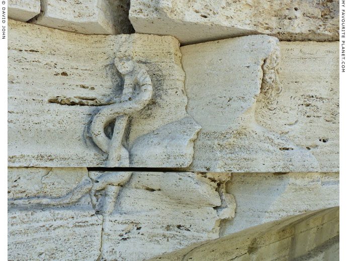The relief of Aesculapius on the facade on the Tiber Island, Rome at My Favourite Planet