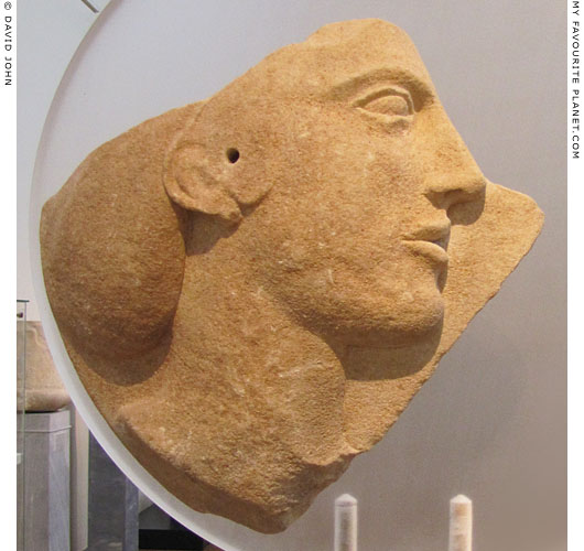 A relief of a female head on a fragment of a marble disc from Melos at My Favourite Planet