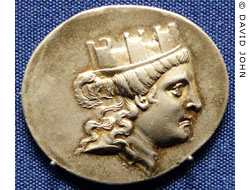Tyche wearing a mural crown on a coin from Smyrna at My Favourite Planet