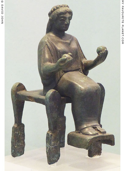Bronze figurine of a seated female holding fruits from Arcadia at My Favourite Planet