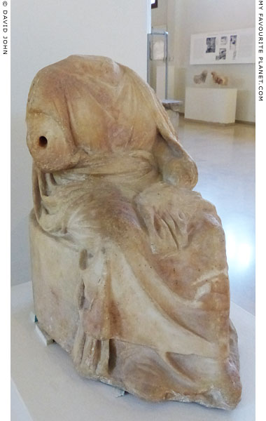 Statuette of Demeter sitting on the sacred kiste, Dion, Macedonia, Greece at My Favourite Planet
