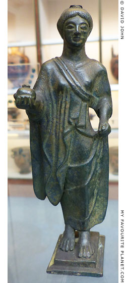 Bronze figure holding a pomegranate from Campania at My Favourite Planet