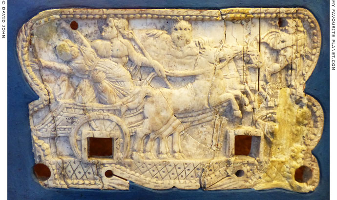 Plouton and Persephone by in a chariot on an ivory plaque at My Favourite Planet