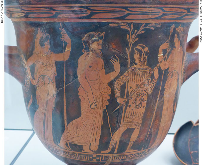A bearded man and Triptolemos in the presence of Demeter and Persephone at My Favourite Planet