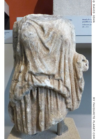 Fragment of a marble statuette of a female figure wearing a peplos at My Favourite Planet