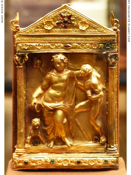 A gold relief of drunken Dionysus with a panther and satyr in a naiskos at My Favourite Planet
